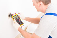 Electrician checking socket Stock Images