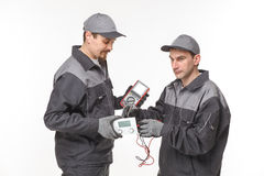 Electrician checking socket voltage with digital multimeter Royalty Free Stock Images