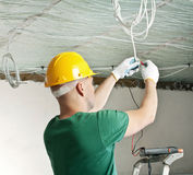 Electrician checking voltage Stock Photography