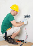 Electrician checking voltage Royalty Free Stock Images