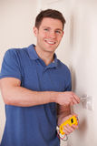 Electrician Checking Wiring On Electrical Switch Royalty Free Stock Image