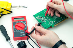 Electrician checks electronic hardware Stock Images
