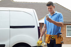 Electrician Checking Message On Mobile Phone Stock Image