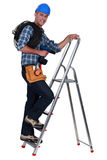 An electrician climbing a ladder. Royalty Free Stock Photos