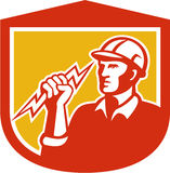 Electrician Clutching Lightning Bolt Shield. Illustration of an electrician construction worker clutching holding a lightning bolt set inside shield done in Royalty Free Stock Photo