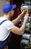 Electrician connecting wires in board. Electrician connecting wires in distribution board Stock Photography