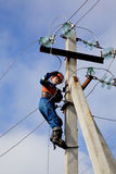 Electrician Connects Wires On A Pole Stock Photo