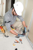 Electrician on construction site Stock Images