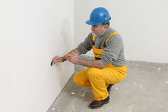 Electrician at construction site testing installation Stock Photos