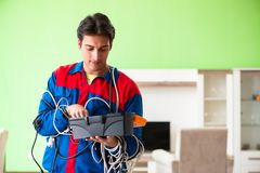 The electrician contractor with tangled cables stock image