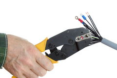 Electrician is crimping a plug Royalty Free Stock Image