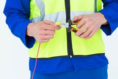 Electrician cutting wire with pliers Royalty Free Stock Photography
