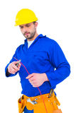 Electrician cutting wire with pliers Royalty Free Stock Image