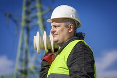 Electrician with a damaged insulators Stock Image