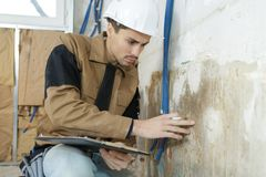 Electrician documenting electrical lines outline. Electrician documenting the electrical lines outline Stock Photo