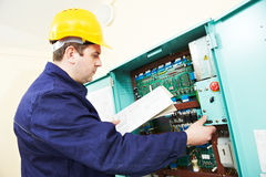 Electrician with drawing at power line box Stock Photos