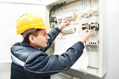 Electrician with drawing at power line box Stock Photography