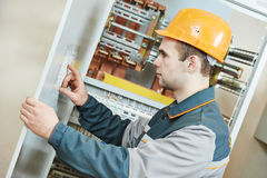 Electrician with electric scheme project Royalty Free Stock Photos