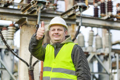 Electrician in electrical substation Stock Photo