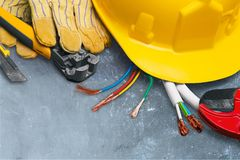 Electrician. Work tool power cable hardhat construction equipment wire cutter construction Royalty Free Stock Photos