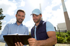 Electrician and engineer checking calendar at the electric stati Royalty Free Stock Photography