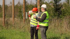 Electrician Engineer explains to worker assigned work stock footage