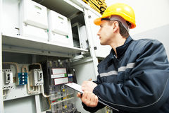 Electrician engineer worker. Electrician builder engineer inspector checking data of equipment in fuse box Stock Photos