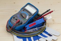 Electrician equipment on white background. Multimeter stock photo