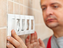 Electrician finished installing electrical wall socket - closeup Royalty Free Stock Image