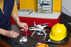 Electrician at work with a quadcopter royalty free stock image