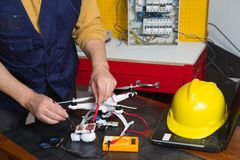 Electrician at work with a quadcopter Royalty Free Stock Photos