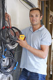 Electrician Fitting Wiring On Construction Site Royalty Free Stock Photo