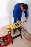 Electrician fixing breaker box Royalty Free Stock Images