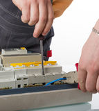 Electrician fixing cable in domestic electrical box Royalty Free Stock Photo