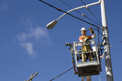 Electrician fixing electrical cables Royalty Free Stock Photo