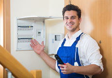 Electrician fixing problems of automatic electric meter Royalty Free Stock Photography