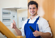 Electrician fixing problems of automatic electric meter Royalty Free Stock Photos