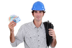 Electrician flashing cash Royalty Free Stock Images