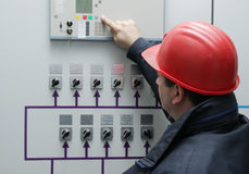 Electrician give command in power plant control center Royalty Free Stock Image