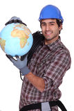 Electrician with a globe Royalty Free Stock Photo