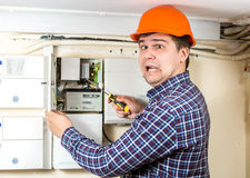 Electrician got high voltage shock while repairing electrical sy Royalty Free Stock Images