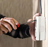 Electrician. Hands of electrician; new wall outlet Stock Images
