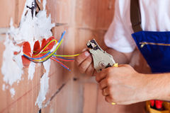 Electrician hands with pliers Stock Photography