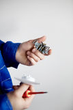 Electrician hands with screwdriver fixing socket. Repair of electricity concept Stock Image