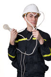 Electrician With Heat And Lamp Royalty Free Stock Image