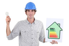 Electrician holding bulb Stock Photo