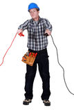 Electrician holding cables Stock Images