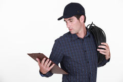 Electrician holding clipboard Royalty Free Stock Images