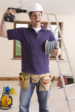 Electrician holding drill to head and making a face Royalty Free Stock Photos