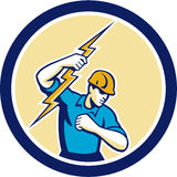 Electrician Holding Lightning Bolt Side Circle. Illustration of an electrician construction worker holding a lightning bolt set inside circle done in retro style Royalty Free Stock Photography